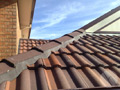 Close-up shot of our attention to detail. Tiles for a roof repair project in suburban Melbourne