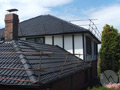 Cement tile roof being restored in Melbourne Suburb